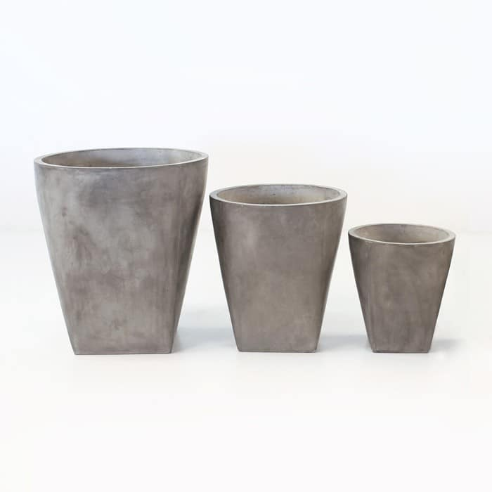 three round BLOK concrete planters