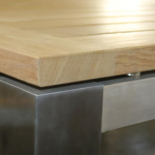 square stainless and teak outdoor dining table closeup
