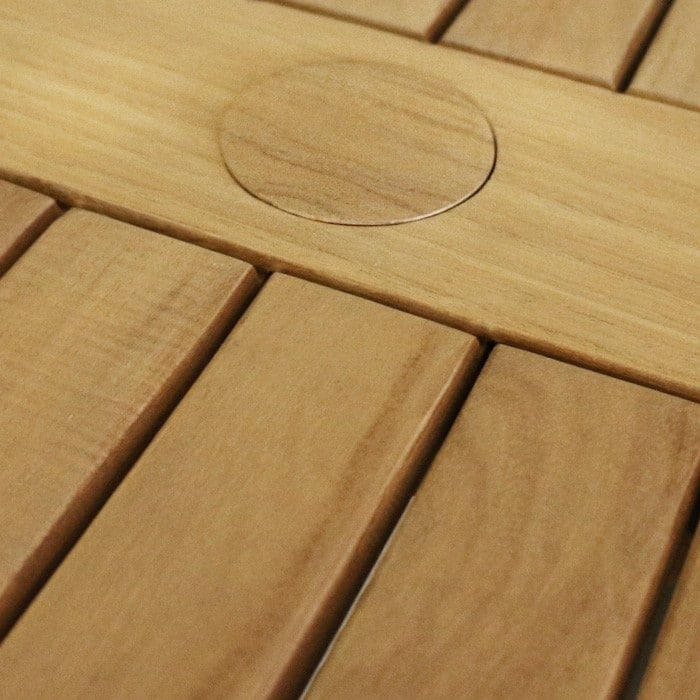 teak table with umbrella hole close up