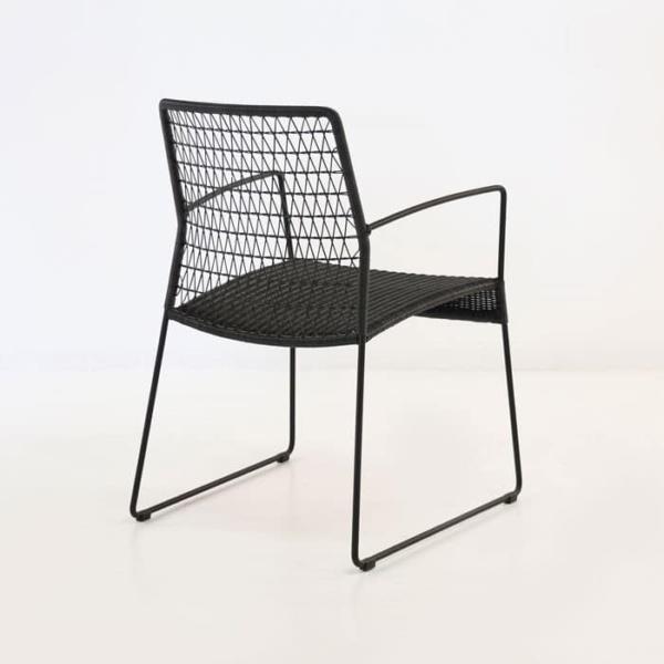 edge wicker arm chair in black rear view