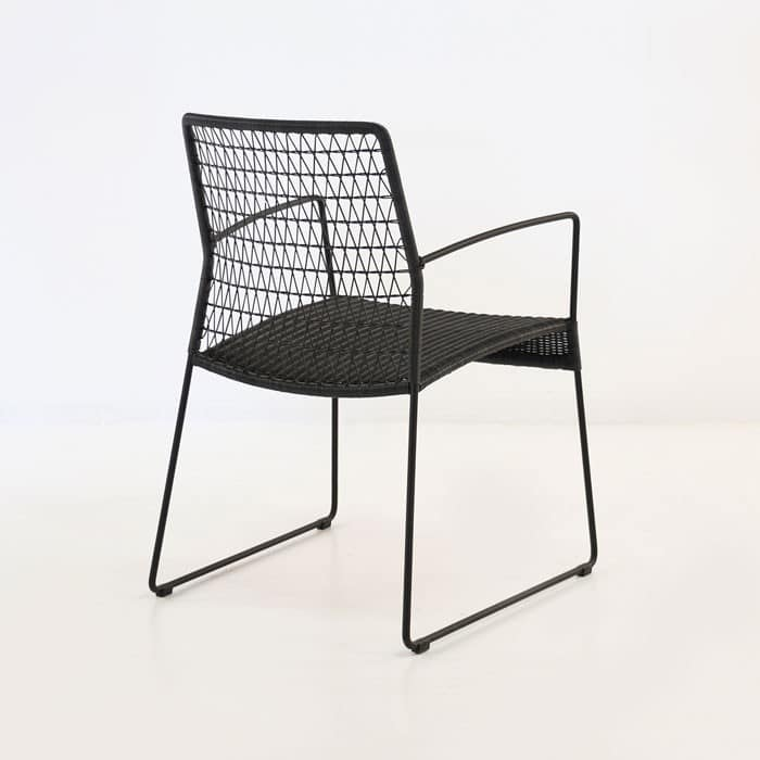 edge wicker arm chair in black rear view