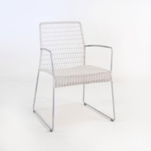 edge wicker arm chair in chalk front angle view