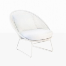 white wicker chair with white cushion