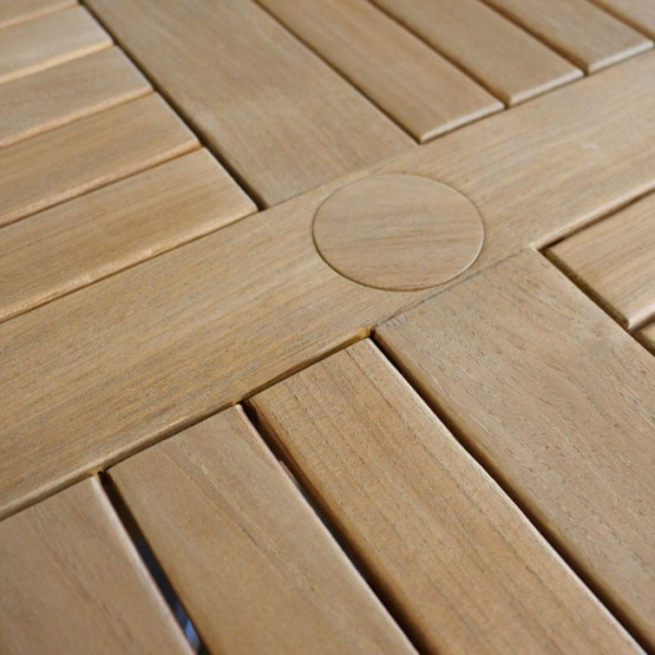 round outdoor teak bar table closeup