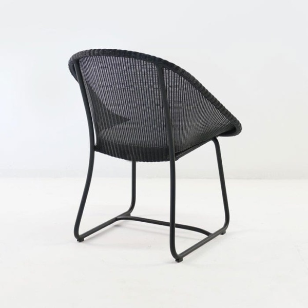 breeze wicker dining arm chair rear view