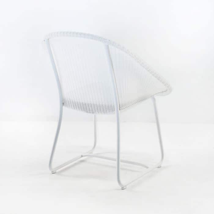 breeze wicker dining arm chair in white rear view