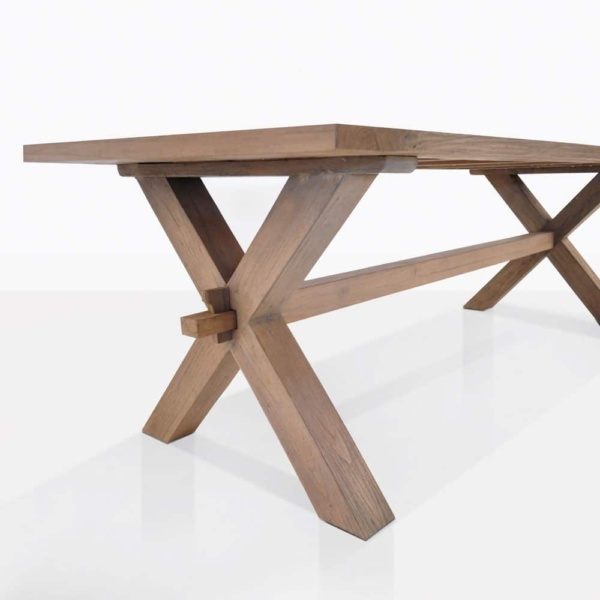 rustic reclaimed teak dining table x leg outdoor closeup