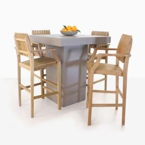concrete table and four teak bar stools