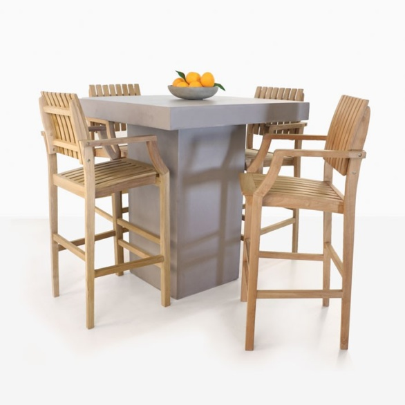 concrete table and four teak bar stools