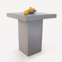 raw concrete bar table with fruit