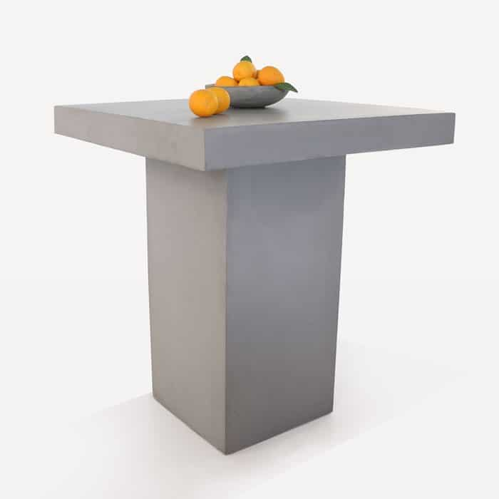 concrete bar table with a bowl of oranges on top
