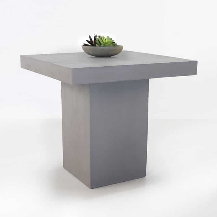 raw concrete counter height table angle view