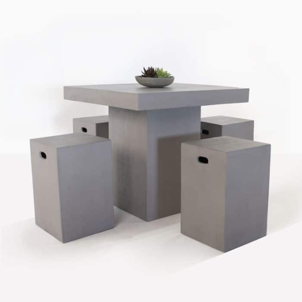 raw concrete square table with 4 chairs