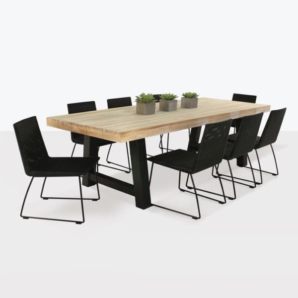 Village reclaimed teak dining table with 8 wicker chairs