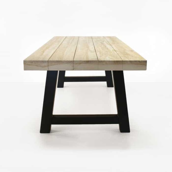 Village reclaimed teak trestle table with black legs