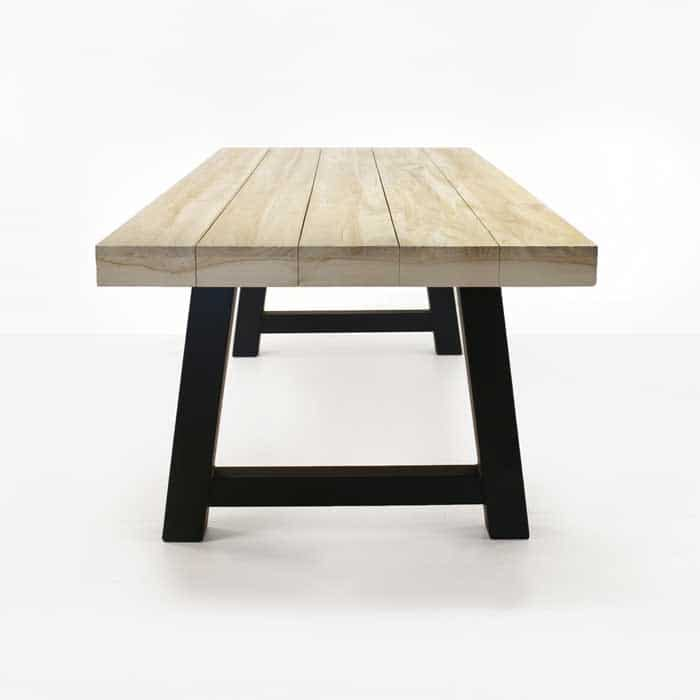Village reclaimed teak trestle table with black legs
