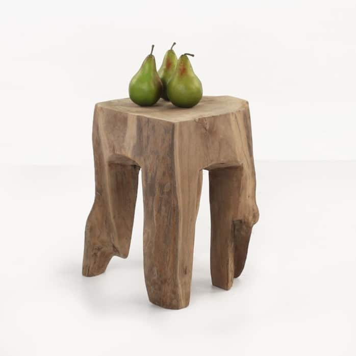 square teak root table with green apples angle view
