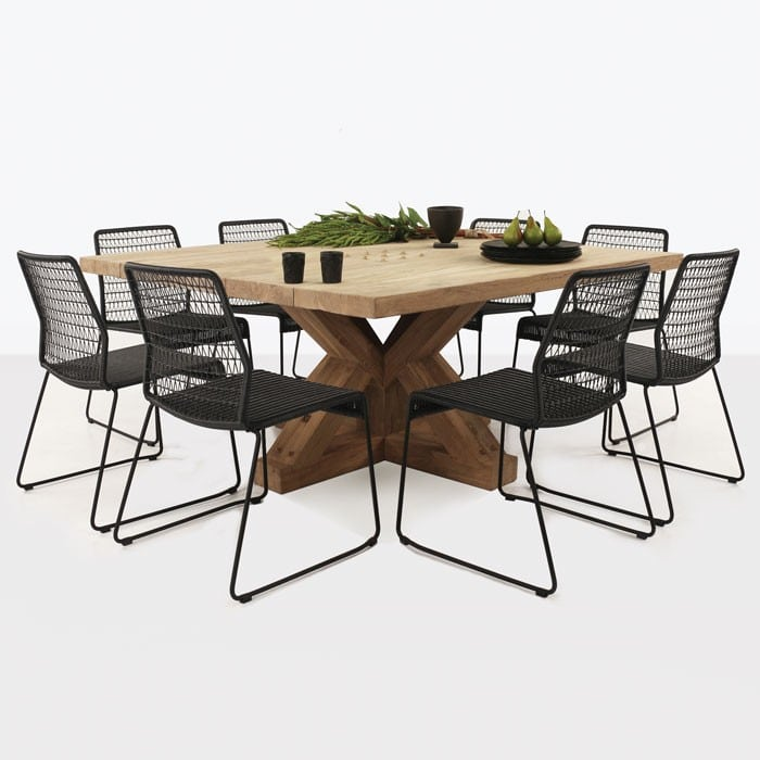 Alex Reclaimed Teak and Wicker Outdoor Dining Set with eight black chairs