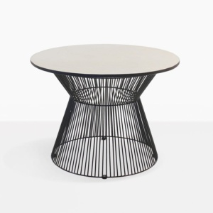 white sand and black deco round side table