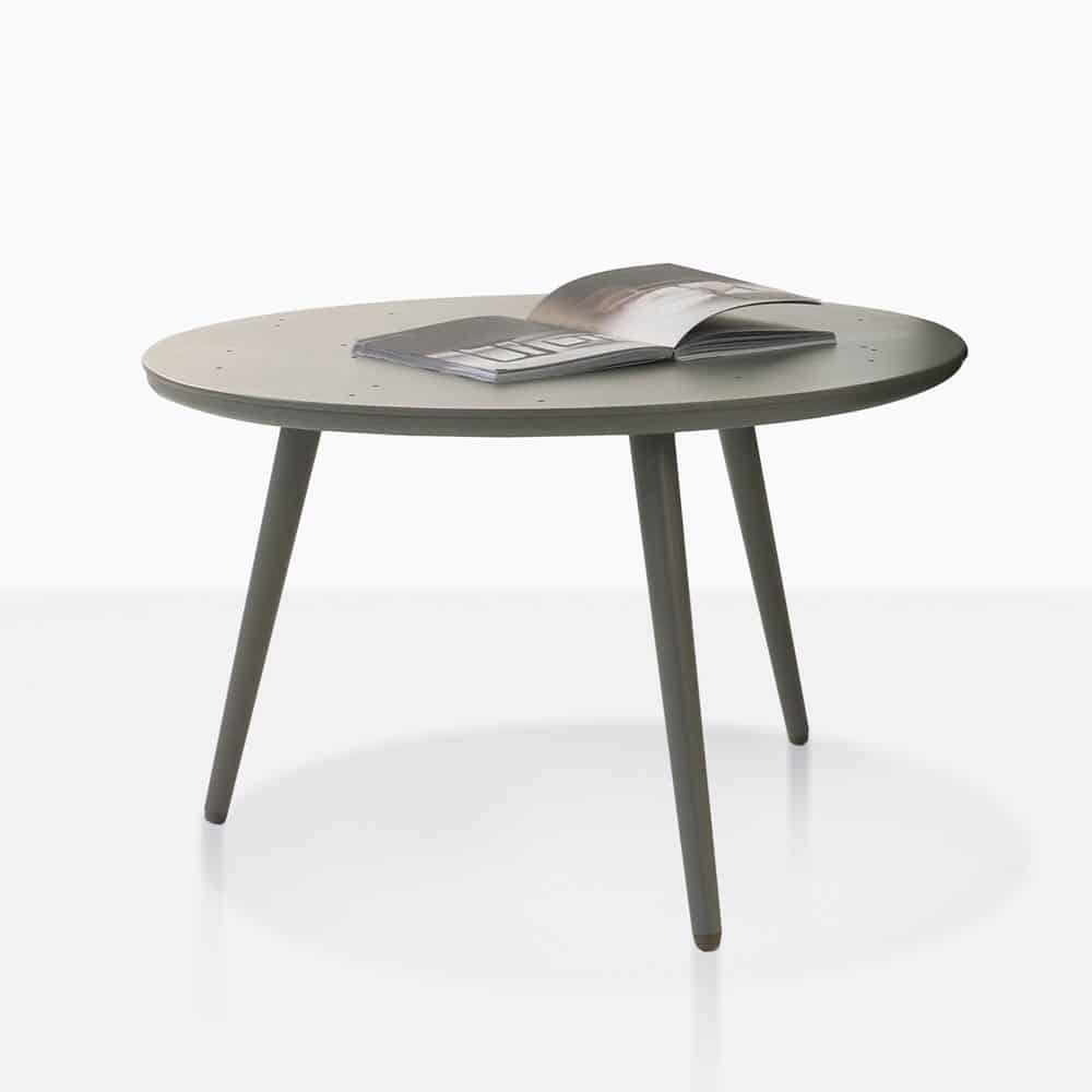 ida aluminum side table in grey with magazine on top