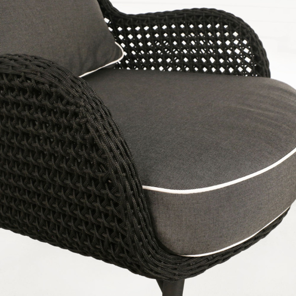 dream high back outdoor relaxing wicker chair black cushions closeup