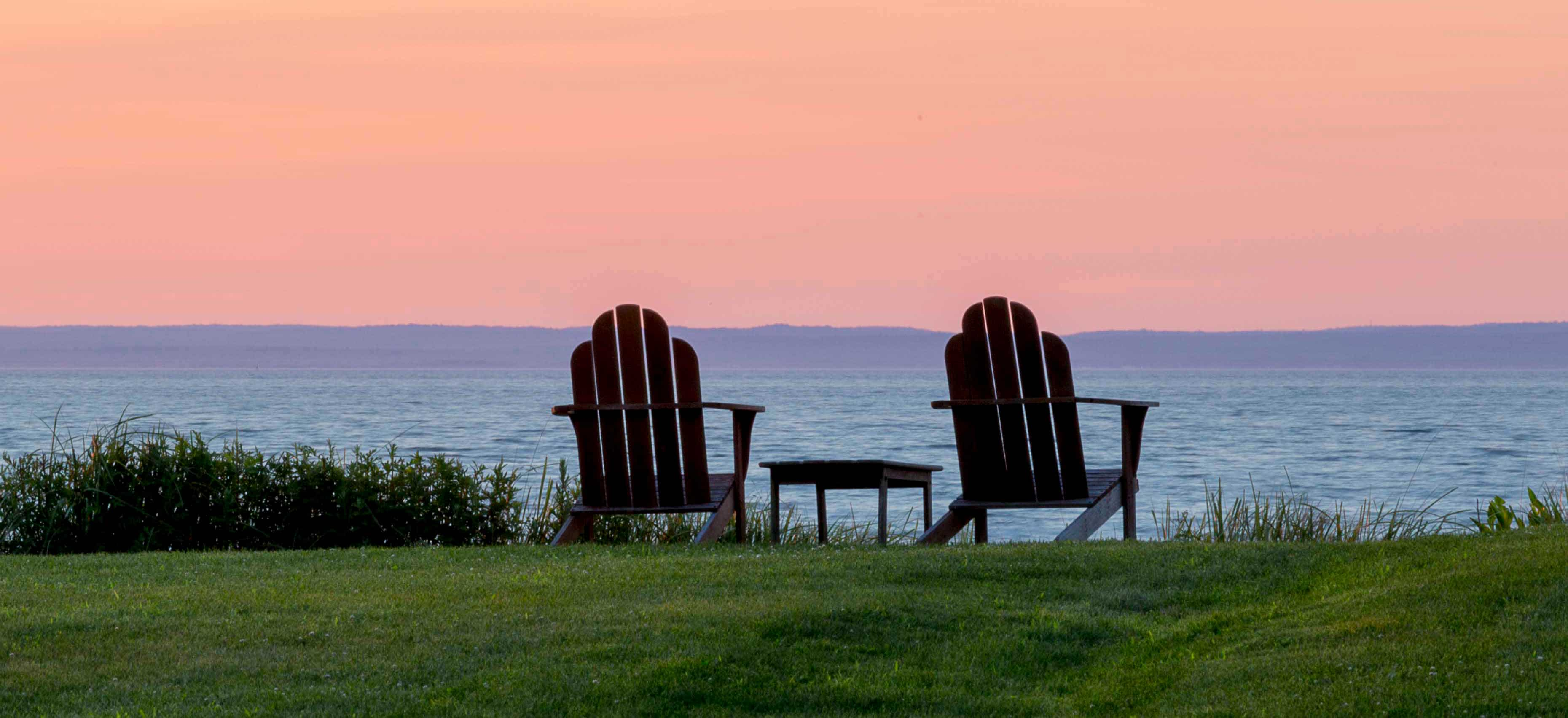 Adirondack Chairs By The Lake