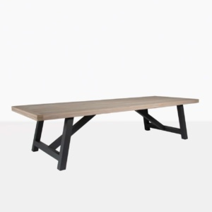 hobson reclaimed teak dining table with graphite aluminium base angle view