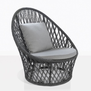 sunai open weave relaxing swivel chair in charcoal angle view