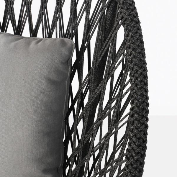 sunai open weave relaxing swivel chair in charcoal closeup view