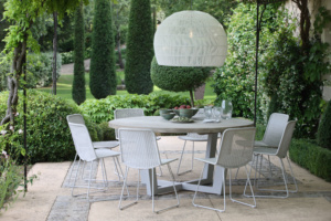 Luxury patio with wicker dining furniture and teak table