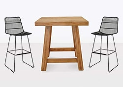 Teak high top table and black bar stools