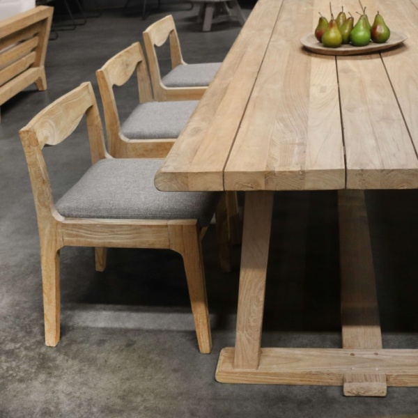 curve reclaimed teak dining chairs with table